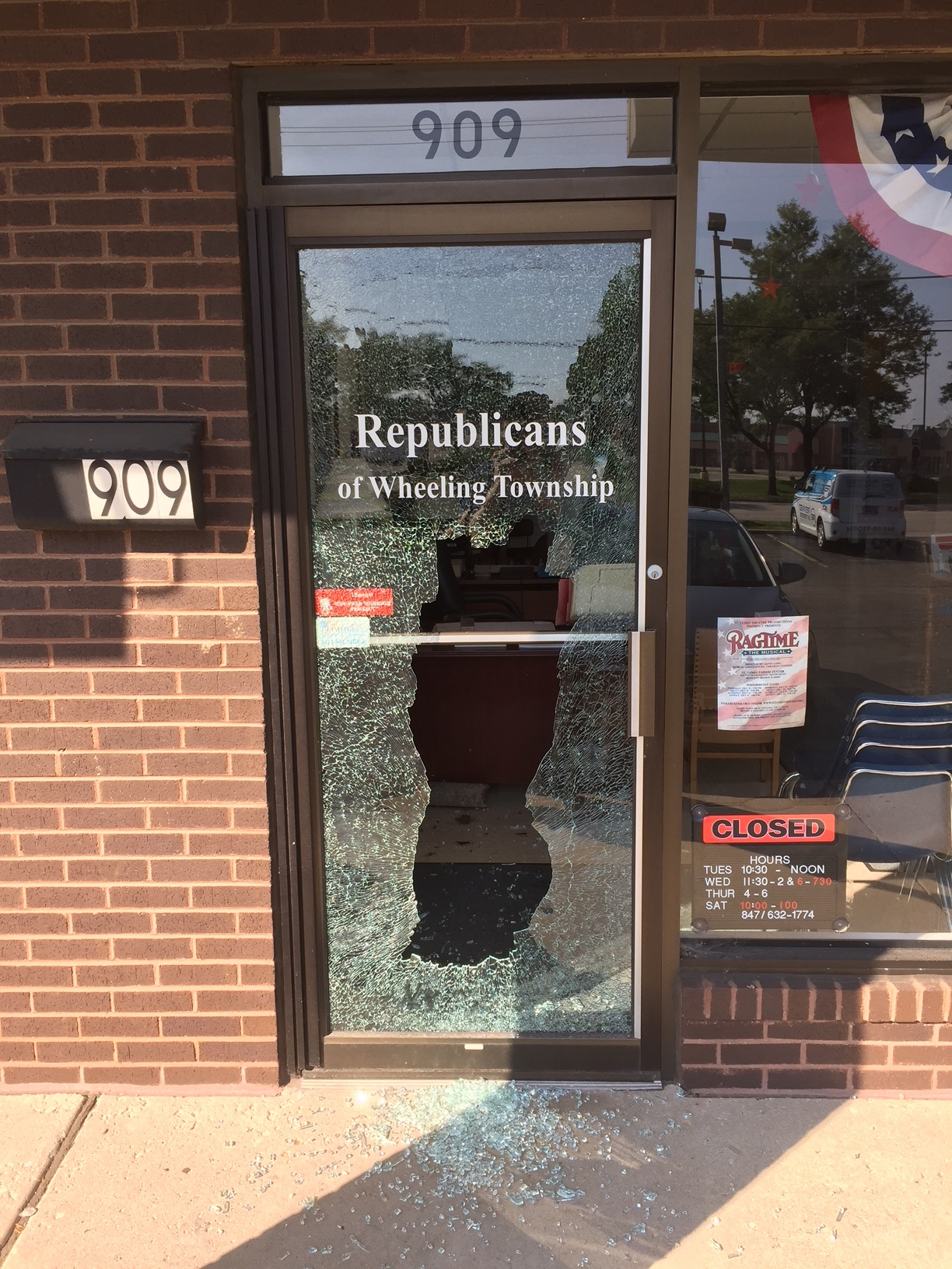 Large rectangular hold in the front door of Wheeling Township Republicans headquarters in Arlington Heights.