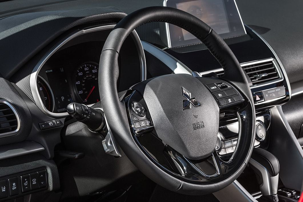 The 2018 Mitsubishi Eclipse Cross has a touchpad controller that you can control with simple swipes and taps.