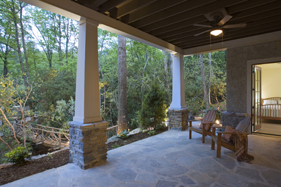 A covered patio extends livable space outside the home's walls.