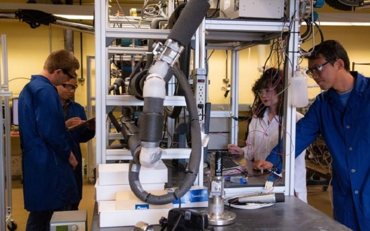 Dr. Carolyn Koh, second from right, in the Center for Hydrate Research lab with her research team.