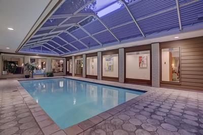 The home boasts a magnificent indoor swimming pool.