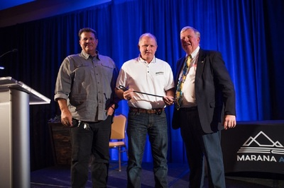 Greg Brchan and Chris Fisher accepted the award for Northwest Landscaping from Mayor Ed Honea.