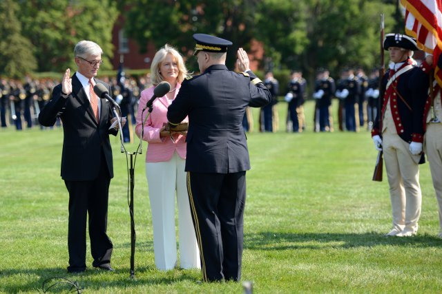 Army Secretary John M. McHugh, far left, swears in Army Chief of Staff Gen. Mark A. Milley as the 39th chief of staff of the Army during a ceremony on Summerall Field, Joint Base Myer-Henderson Hall, Va., Aug. 14, 2015. Milley's wife, Hollyanne, holds the