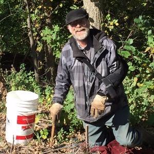 PHNRC Commissioner Peter Hahn planting red oak seedlings.