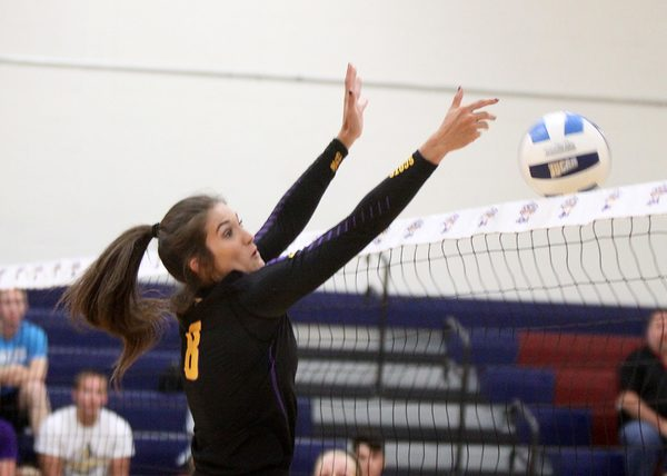McHenry middle blocker Kayli Trausch defends against a kill.