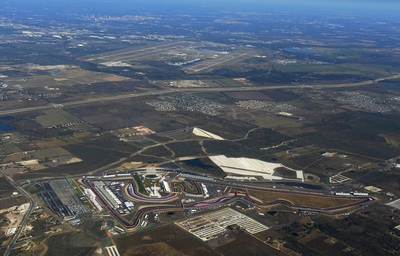 This aerial photo show the Circuit of the Americas with Austin-Bergstrom International Airport and downtown Austin in the far background