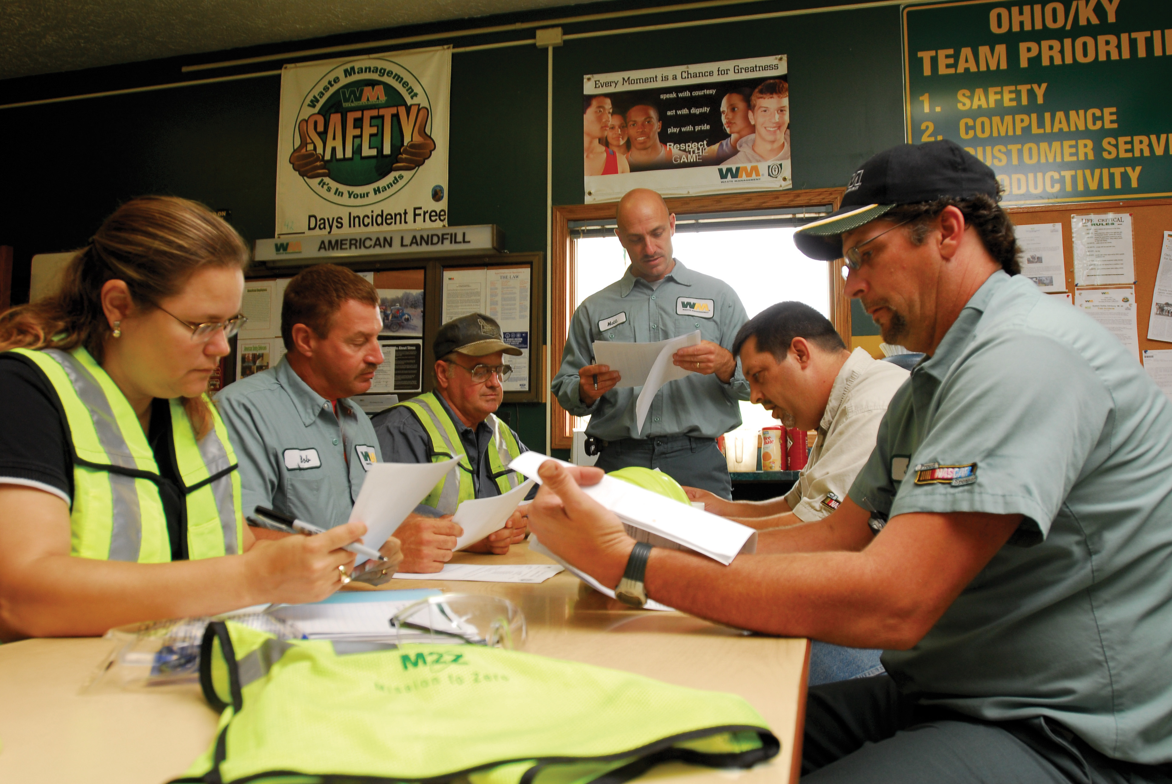 Waste Management employees discuss safety issues at a required weekly meeting.
