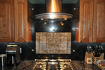 Range hoods can be highly decorative, but they serve a needed function.