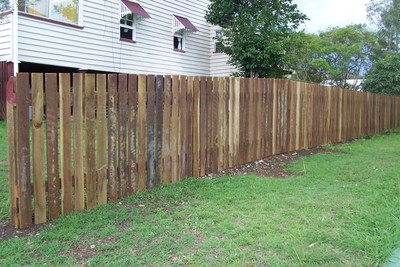 Stain your wooden fence properly to help protect it from the weather.