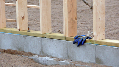 The top of the foundation should be at least 4 inches above the ground.
