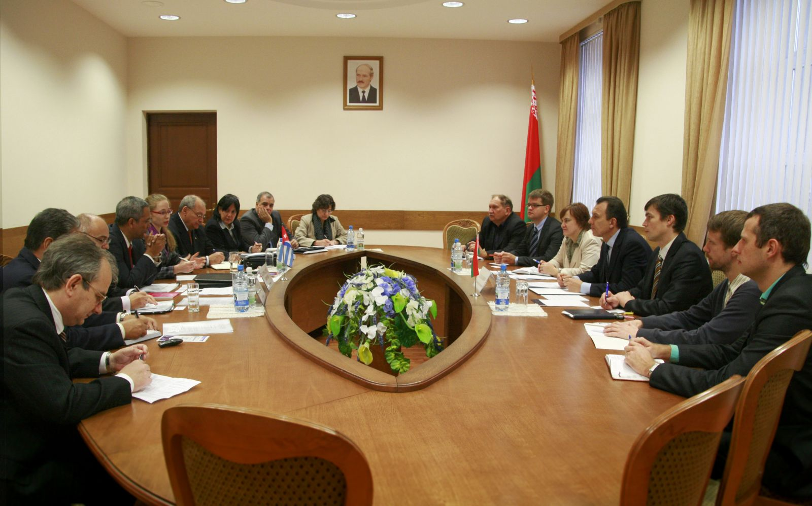 Delegates from Belarus and Cuba convene to discuss economic cooperation and trade between the two countries.