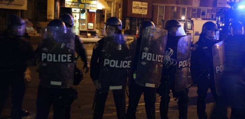 Riot police form a line to push back protesters and media, Baltimore, April 28, 2015.