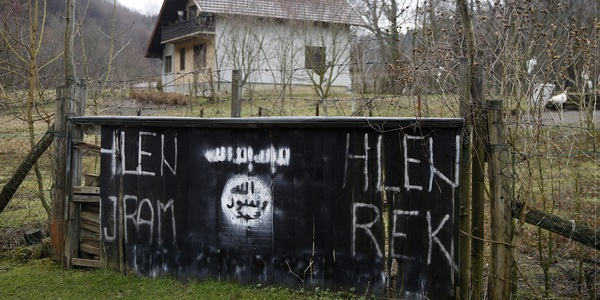 An entrance to Gornja Maoca, a Bosnian village, is decorated with ISIS signs.