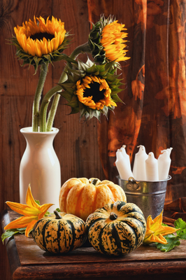 Sunflowers and gourds make a pretty fall centerpiece.