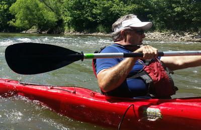 Rick Tollakson paddles down Beaver Creek