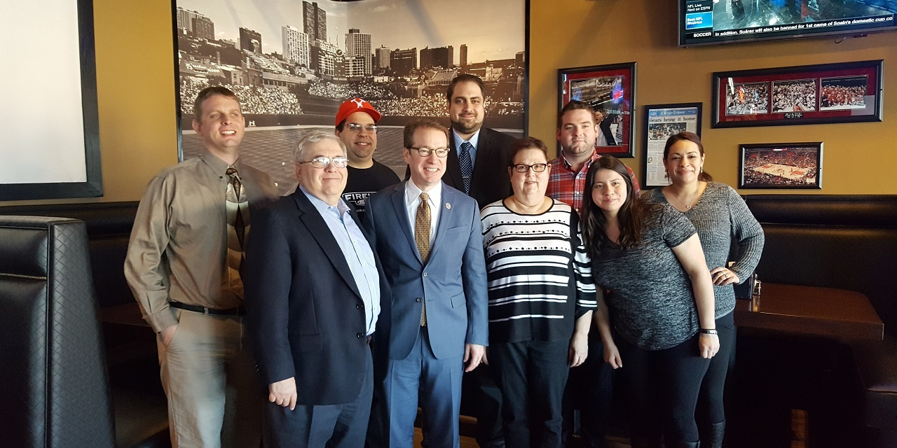 Rep. Peter Roskam, front row second from left, led a tax tour of Chicago's suburbs last week.