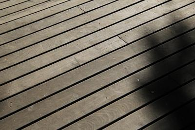 Wash, bleach and seal a wood deck annually to make it last.