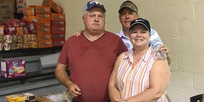 Charleston attorney Rusty Webb (rear) has been delivering flood relief supplies to several affected communities, including  a load to a relief center at Richwood Middle School. (Courtesy photo)