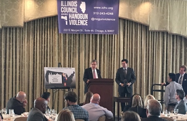 U.S. Sen. Mark Kirk (R-IL), at the podium, receives the Abraham Lincoln Award from the Illinois Council Against Handgun Violence on Monday.