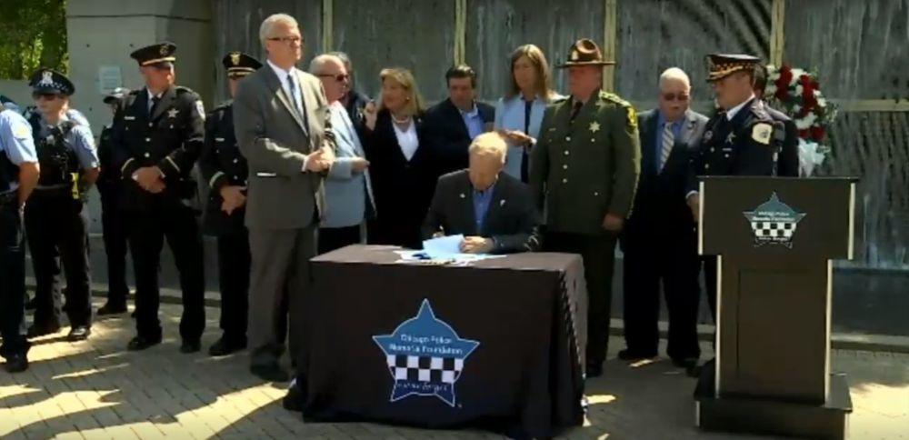 Gov. Bruce Rauner and GOP House Leader Rep. Jim Durkin (R-Western Springs) signing HB5513 on July 30.
