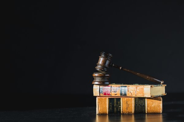 Large gavel on law books