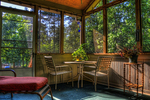 A screened-in porch is a blessing in good Texas weather.