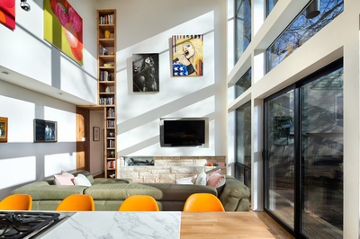 An addition to the back of this former duplex in South Austin created an open, high-ceilinged living area.
