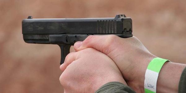 Large man holding handgun