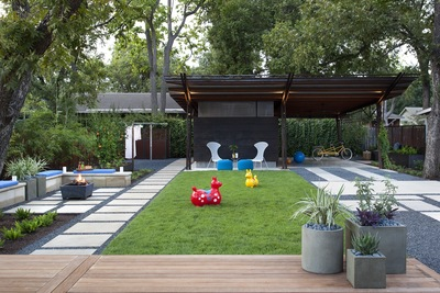 A small sport court can be used for children's play, bocce ball and even tea parties.