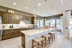 Kitchens are laid out to optimize cooking while still spending time with family and friends