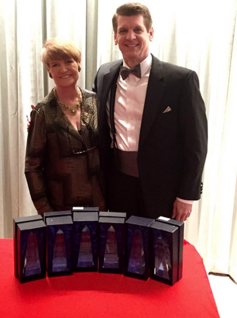 Cameron Wilson accepted awards on LS3P's behalf from Agnes Wilcox, 2015 ASID Carolinas president.