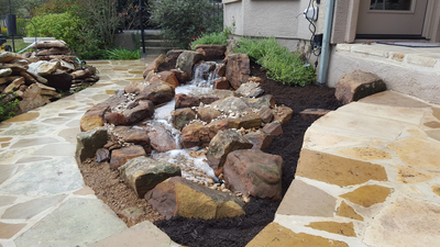 Waterfalls add a touch of organic elegance to a backyard setting.
