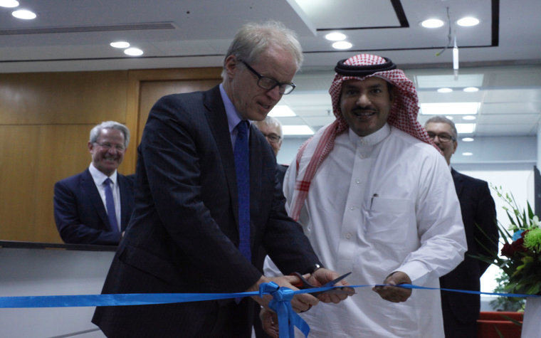 Varian CEO, Dow Wilson, cuts the ribbon, watched by Mazyad Al Utaibi, Varian's regional director in Saudi Arabia, at the official opening of Varian Medical Systems Arabia in Riyadh.