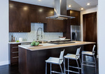 Remodeling the kitchen of a cookie cutter home can add a modern feel