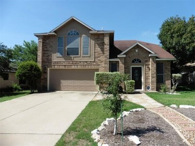 Cathedral ceilings, tiled floors and a spacious master outfit this home.