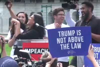 """They didn't say it,"" U.S. House Rep. Rashida Harbi Tlaib says to an aide after she failed to get the crowd to respond with a perjorative about impeaching the president."