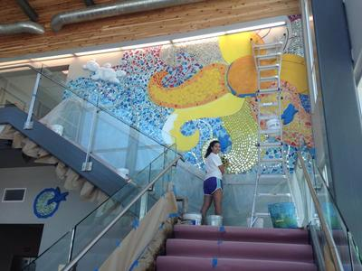 Allegra Benz works on a mural at the Rise School of Austin as part of her volunteerism with the organization.