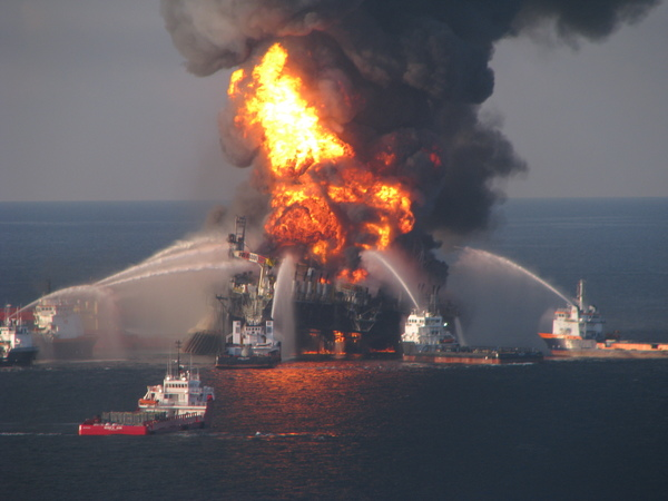 Deepwater Horizon, consumed in flames, towers above the Gulf of Mexico