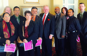 Bolingbrook Mayor Roger C. Claar (middle) surrounded by the local hotel operators association.