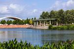 An early 20th-century airport hangar converted for public use as an amphitheater distinguishes the skyline by Mueller Lake Park.