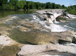 The water of Onion Creek, a tributary of the Colorado River, goes over the upper falls at McKinney Falls State Park.