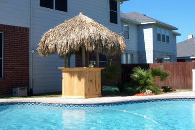 A basic tiki bar has three components: a roof, a frame and a base.
