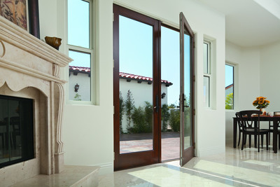 Contemporary-styled patio doors that swing inside a home are becoming more popular in the Austin area.