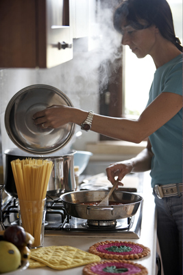 Keeping pots and pans covered helps save energy and bring liquids to a boil quicker.