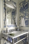 Small bathrooms can be accented with soothing wallpaper choices