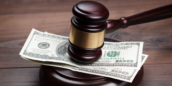Large judge gavel and money on brown wooden table 1280x640