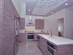 Kitchen islands are taking on a sleek, modern look in Austin area kitchens.