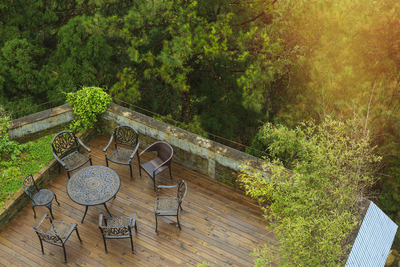 An outdoor deck extends the livable area of the home and creates a pleasant dining environment.