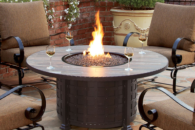 Fire tables offer the allure of a standard fire pit, but are compact and mobile.