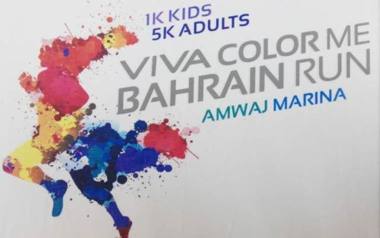 Colored powder kicked up by runners paints participants in the Color Me Bahrain runs.